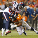 Houston Texans wide receiver Andre Johnson (80) is hit by Denver Broncos cornerback Bradley Roby (29) during the first half of an NFL preseason football game, Saturday, Aug. 23, 2014, in Denver The Associated Press