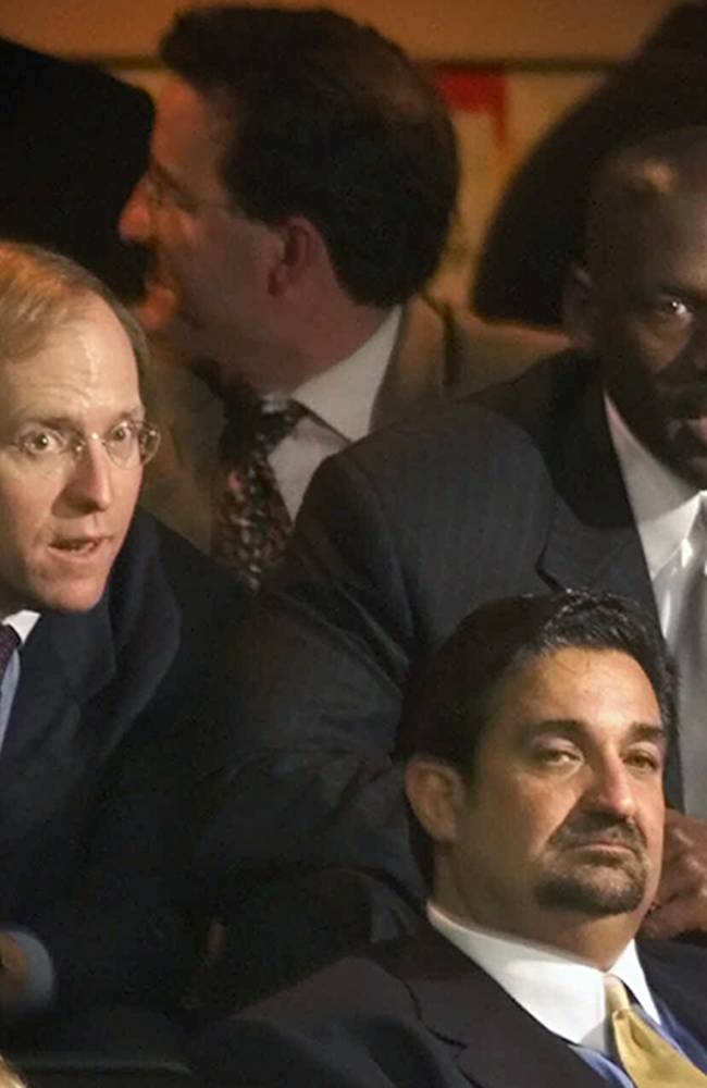 In this Jan. 19, 2000, file photo, former Chicago Bulls great Michael Jordan, rear right, sits in the owner's sky box with Washington Capitals minority owner Jon Ledecky, left, and Washington Wizards minority owner Ted Leonsis, front, during an NBA game at the MCI Center in Washington. The Islanders have announced that the team is being sold to a former Washington Capitals co-owner and a London-based investor. In a statement Tuesday, Aug. 19, 2014, the team says a group led by former Capitals co-owner Jon Ledecky and investor Scott Malkin has reached an agreement to buy a