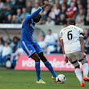 Chelsea's Demba Ba, left, scores his teams opening goal during their English Premier League soccer match against Swansea City at the Liberty Stadium, Swansea, Wales, Sunday, April 13, 2014
