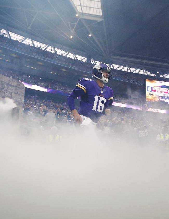 Minnesota Vikings quarterback Matt Cassel runs onto the field before the NFL football game against the Pittsburgh Steelers at Wembley Stadium, London, Sunday,Sept. 29, 2013