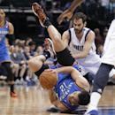 Oklahoma City Thunder center Steven Adams (12) goes down with the ball against Dallas Mavericks guard Jose Calderon, of Span, during the first half of an NBA basketball game Tuesday, March 25, 2014, in Dallas The Associated Press