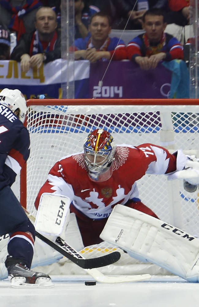 In this Feb. 15, 2014 file photo, Russia goaltender Sergei Bobrovsky defends a shot by USA forward T.J. Oshie (74) during a shootout in a men's ice hockey game at the 2014 Winter Olympics in Sochi, Russia. All of the Columbus Blue Jackets including Bobrovsky are back with the team and preparing for the NHL season's restart after a three-week respite
