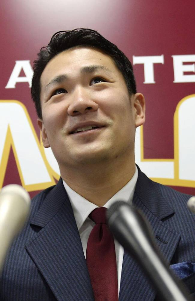 In this Dec. 17, 2013 file photo, Rakuten Golden Eagles pitcher Masahiro Tanaka speaks at a press conference after a meeting with his club president, in Sendai, northern Japan. Tanaka's team says it has decided to let him seek his career in Major League baseball next season, reversing its earlier rejection. Rakuten Eagles president Yozo Tachibana told a news conference Wednesday, Dec. 25, 2013 that it has decided to release him through the posting system