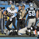 New Orleans Saints' Jimmy Graham, top, catches touchdown pass against Carolina Panthers' Melvin White, bottom, in the first half of an NFL football game in Charlotte, N.C., Thursday, Oct. 30, 2014 The Associated Press