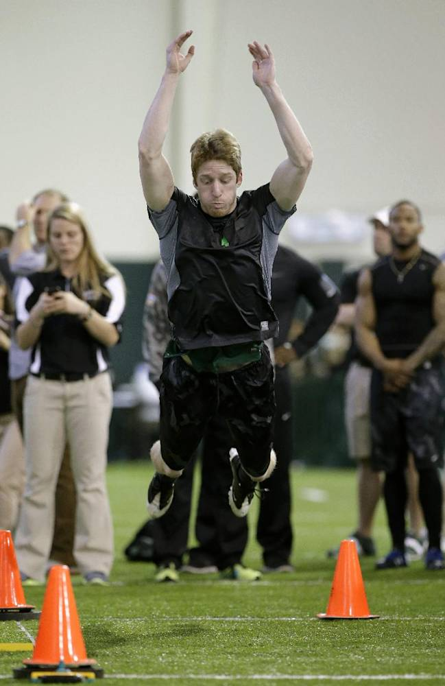 Baylor kicker Aaron Jones leaps in the broad jump during pro day for NFL football representatives on Wednesday, March 19, 2014, in Waco, Texas