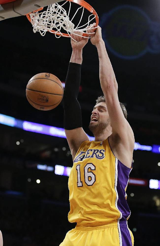 Los Angeles Lakers center Pau Gasol dunks against the Phoenix Suns during the first half of an NBA basketball game in Los Angeles, Tuesday, Dec. 10, 2013