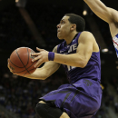 Kansas State guard Angel Rodriguez (13) puts up a shot  during the first half of the championship NCAA college basketball game against Kansas in the Big 12 men's tournament Saturday, March 16, 2013, in Kansas City, Mo. (AP Photo/Charlie Riedel)