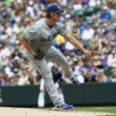 Los Angeles Dodgers starting pitcher Clayton Kershaw works against the Colorado Rockies in the first inning of a baseball game in Denver on Monday, Sept. 2, 2013. (AP Photo/David Zalubowski)