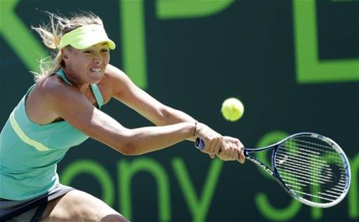 Maria Sharapova, of Russia, returns to Jelena Jankovic, of Serbia, during the semifinals of the Sony Open tennis tournament in Key Biscayne, Fla., Thursday, March 28, 2013. Sharapova won 6-2, 6-1