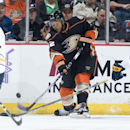 The Ducks' Devante Smith-Pelly battles for the puck with the Sabres' Tyler Myers and Brian Gionta, left, during the second period at Honda Center Wednesday night Oct. 22, 2014 The Associated Press