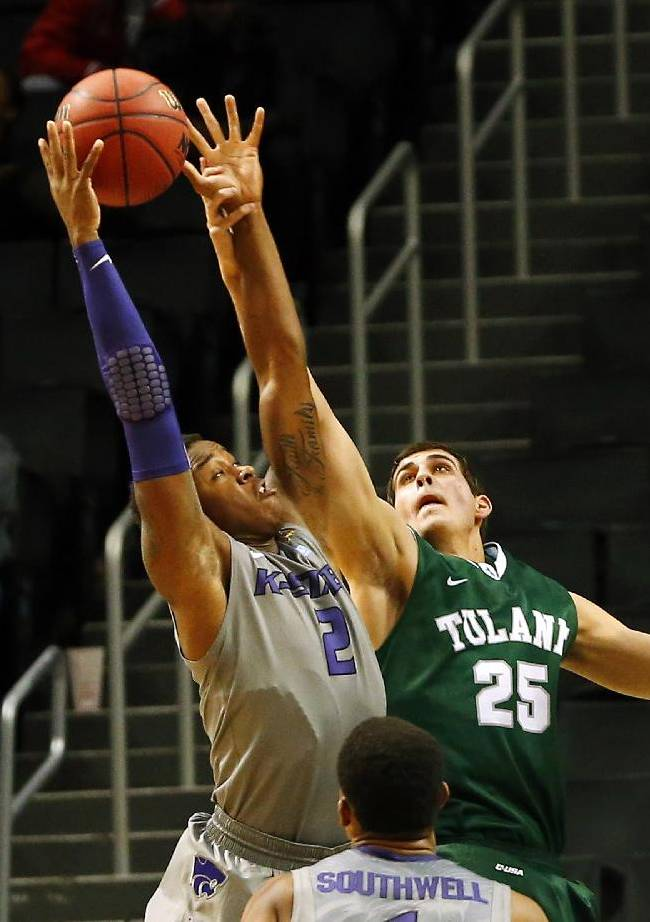Kansas State's Marcus Foster (2) pulls a rebound away from Tulane's Payton Henson (25) during the second half of an NCAA college basketball game Saturday, Dec. 28, 2013, in New York. Kansas State won 72-41
