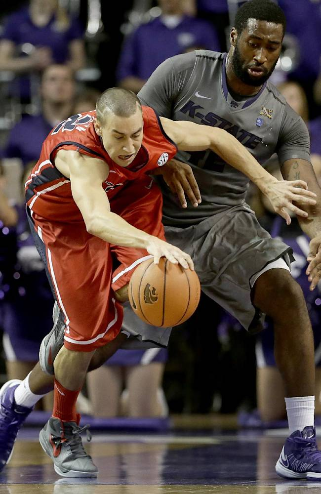 Kansas State's Thomas Gipson, right, tries to steal the ball from Mississippi's Marshall Henderson during the second half of an NCAA college basketball game Thursday, Dec. 5, 2013, in Manhattan, Kan