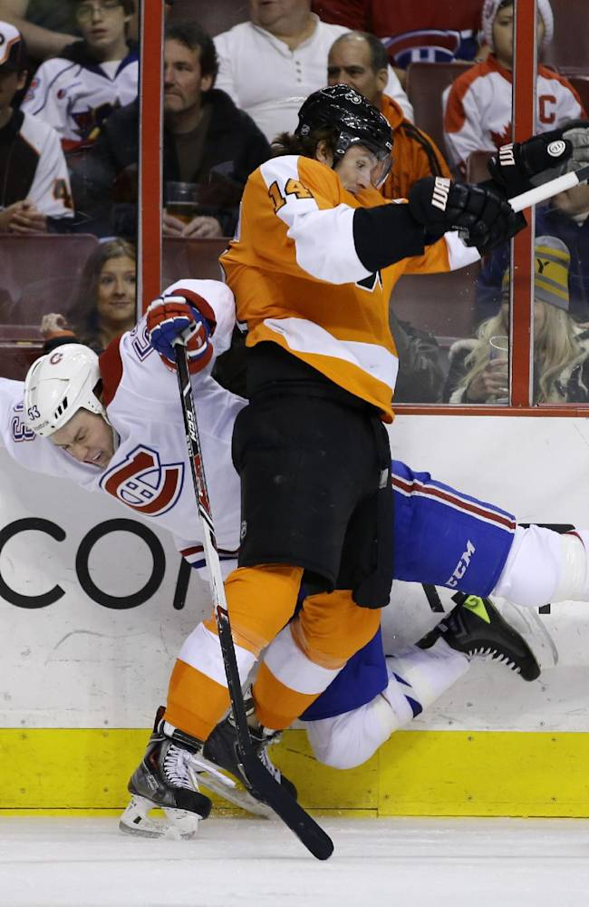 Philadelphia Flyers' Sean Couturier, right, and Montreal Canadiens' Ryan White collide during the first period of an NHL hockey game, Thursday, Dec. 12, 2013, in Philadelphia