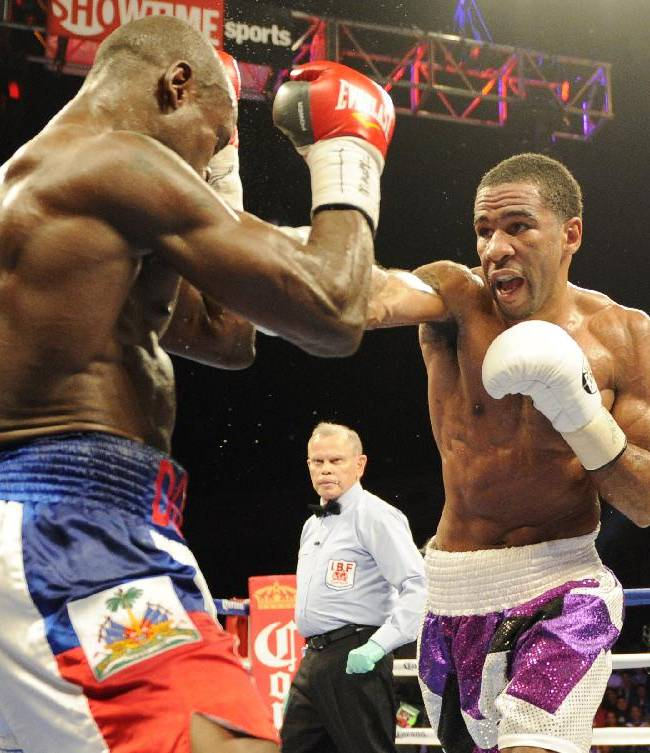 Lamont Peterson, right, punches Dierry Jean, of Canada, left, during the IBF Junior welterweight title boxing match, Saturday, Jan. 25, 2014, in Washington. Peterson won the match