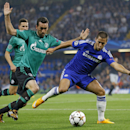 Chelsea's Eden Hazard, right, and Schalke's Christian Fuchs challenge for the ball during the Champions League Group G soccer match between Chelsea and Schalke 04 at Stamford Bridge stadium in London Wednesday, Sept. 17, 2014