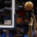 The arm of Cleveland Cavaliers' Luol Deng, of Sudan, right, shoots the ball over the reach of Atlanta Hawks' Elton Brand in the first quarter of an NBA basketball game, Friday, April 4, 2014, in Atlanta The Associated Press