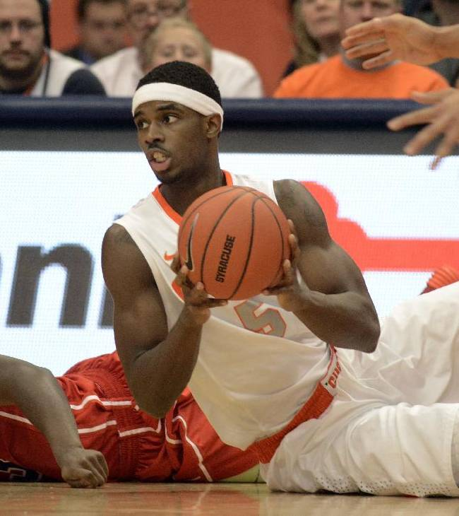 Syracuse's C. J. Fair looks for someone to pass to after grabbing a loose ball against St. Francis during the first half of an NCAA college basketball game in Syracuse, N.Y., Monday, Nov. 18, 2013