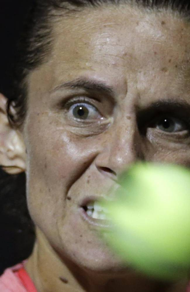 Roberta Vinci of Italy returns the ball against Lucie Safarova of the Czech Republic, during their second round match of Pan Pacific Open tennis tournament in Tokyo, Monday, Sept. 23, 2013