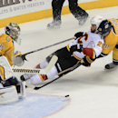 Calgary Flames left wing Brandon Bollig (25) has his shot blocked by Nashville Predators goalie Pekka Rinne (35) as he is defended by Predators defenseman Anton Volchenkov (20) in the first period of an NHL hockey game Tuesday, Oct. 14, 2014, in Nashville