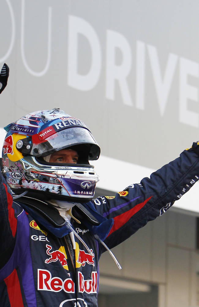 Red Bull driver Sebastian Vettel of Germany celebrates  after winning the Japanese Formula One Grand Prix at the Suzuka circuit in Suzuka, Japan, Sunday, Oct. 13, 2013