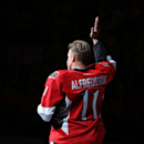 Daniel Alfredsson, of Sweden, acknowledges fans as he takes part in the warmup skate before the Ottawa Senators play the New York Islanders in NHL hockey game action in Ottawa, Ontario, Thursday, Dec. 4, 2014. The 41-year-old, who signed a ceremonial one-