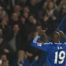 Chelsea's Demba Ba celebrates after scoring against Tottenham Hotspur's /tot, during their English Premier League soccer match, at the Stamford Bridge Stadium in London, Saturday, March 8, 2014