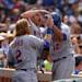 New York Mets' Juan Lagares (12) is congratulated by teammates Justin Turner (2) and Anthony Recker after hitting a two-run home run in the seventh inning of a baseball game against the Chicago Cubs in Chicago on Sunday, May 19, 2013