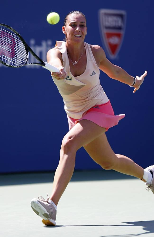 Flavia Pennetta, of Italy, returns a shot to Nicole Gibbs, of the United States, during the third round of the 2014 U.S. Open tennis tournament, Saturday, Aug. 30, 2014, in New York