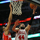 No Rose, no Butler, short-handed Bulls beat Wizards 97-92 The Associated Press