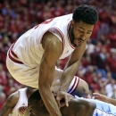 North Carolina's Joel James, bottom, is fouled by Indiana's Christian Watford as he goes up for a shot during the first half of an NCAA college basketball game, Tuesday, Nov. 27, 2012, in Bloomington, Ind. (AP Photo/Darron Cummings)