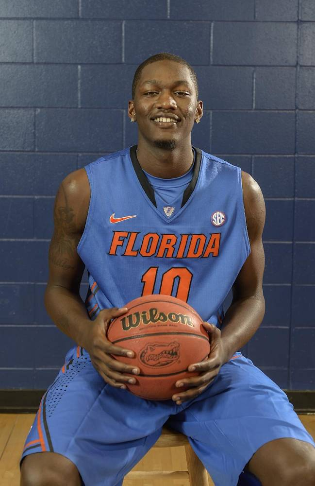 Florida's Dorian Finney-Smith (10) poses during The University of Florida's Basketball Media Day in Gainesville, Fla., Oct. 9, 2013