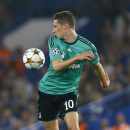 Schalke's Julian Draxler watches the ball during the Champions League Group G soccer match between Chelsea and Schalke 04 at Stamford Bridge stadium in London Wednesday, Sept. 17, 2014
