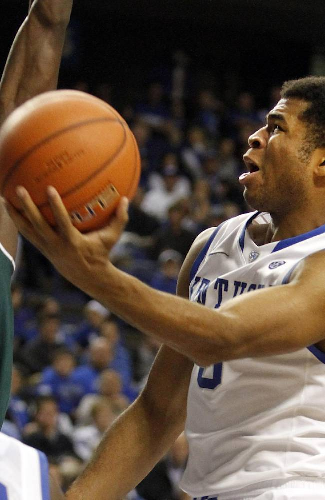 Kentucky's Andrew Harrison, right, shoots under pressure from Eastern Michigan's Glenn Bryant (23) during the second half of an NCAA college basketball game on Wednesday, Nov. 27, 2013, in Lexington, Ky. Kentucky won 81-63