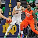 Notre Dame forward Zach Auguste (30) waits for a pass as Syracuse forward Rakeem Christmas (25) defends in the first half of an NCAA college basketball game Tuesday, Feb. 24, 2015, in South Bend, Ind. (AP Photo/Joe Raymond)