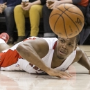 Toronto Raptors' Kyle Lowry lies on the court after being fouled by Milwaukee Bucks' Brandon Knight during first half NBA basketball action in Toronto on Monday, April 14, 2014 The Associated Press