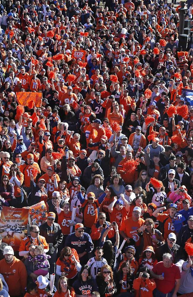 Denver Broncos fans cheer at a pep rally in downtown in Denver, Friday, Jan. 17, 2014. The Broncos are scheduled to host the New England Patriots on Sunday in the AFC championship NFL football game
