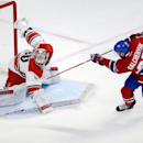 Montreal Canadiens center Alex Galchenyuk (27) scores on Carolina Hurricanes goalie Cam Ward (30) during the third period of an NHL hockey game Tuesday, Dec. 16, 2014, in Montreal The Associated Press