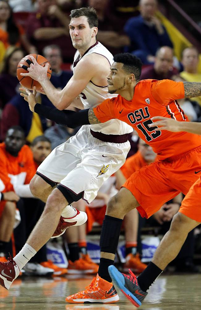 Oregon State's Eric Moreland (15) and Arizona State's Jordan Bachynski chase down a lose ball during the first half of an NCAA college basketball game, Thursday, Feb. 6, 2014, in Tempe, Ariz