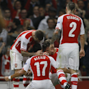 Arsenal's Alexis Sanchez, number 17, celebrates with teammates after scoring a goal during a second leg Champions League qualifying soccer match between Arsenal and Besiktas at Emirates Stadium in London Wednesday, Aug. 27, 2014.(AP Photo/Kirsty Wiggleswo