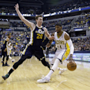 Utah Jazz guard Gordon Hayward, left, fouls Indiana Pacers forward Paul George as he drives the baseline in the first half of an NBA basketball game in Indianapolis, Sunday, March 2, 2014 The Associated Press