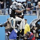 Carolina Panthers' Jonathan Stewart (28) and Cam Newton (1) celebrate Stewart's touchdown against the Cleveland Browns in the second half of an NFL football game in Charlotte, N.C., Sunday, Dec. 21, 2014. (AP Photo/Bob Leverone)