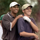 FILE - In this April 9, 1999 file photo, Tiger Woods, left, grabs the shoulders of Sergio Garcia, from Spain, after Garcia's drive on the second hole during the second round of the Masters golf turnament at the Augusta National Golf Club in Augusta, Ga. Garcia was at a European Tour awards dinner Tuesday night, May 21, 2013 when he was jokingly asked if he would have Woods over for dinner during the U.S. Open. The Spaniard replied,