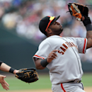 San Francisco Giants third baseman Pablo Sandoval snares a pop fly off the bat of Colorado Rockies' Troy Tulowtizki to end the fourth inning of a baseball game in Denver, Wednesday, April 23, 2014 The Associated Press