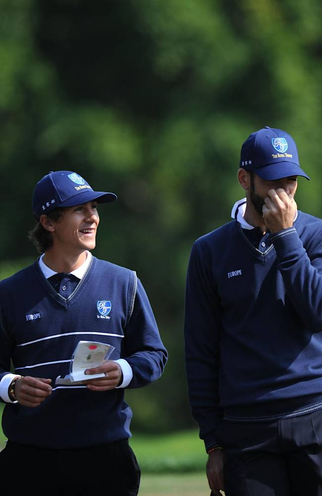 Thorbjorn Olesen, left, of Denmark, and Alvaro Quiros, right, of Spain, walk during their Foursomes Match against Asian team's K.T. Kim and H.S. Kim of South Korea at the Royal Trophy-Europe vs. Asia Golf Championship at Dragon Lake Golf Club in Guangzhou, in south China's Guangdong province, Friday, Dec. 20, 2013