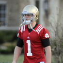 Notre Dame quarterback Gunner Kiel walks to the practice field in South Bend, Ind. A source close to the Irish team confirmed that Kiel and the Irish staff deliberated Thursday afternoon about the possibility of the freshman from Columbus, Ind. leaving the program after the spring semester with the intention of transferring according to the South Bend Tribune. (AP Photo/Joe Raymond)
