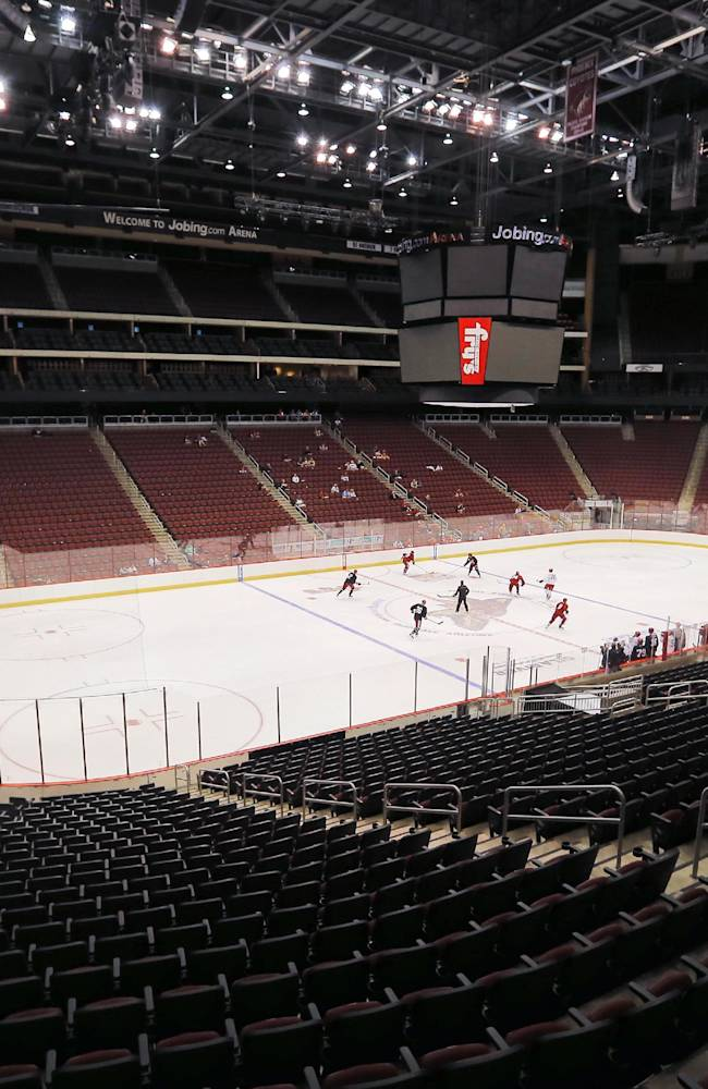 The Phoenix Coyotes run drills during the first day of NHL training camp, Thursday, Sept. 12, 2013, in Glendale, Ariz