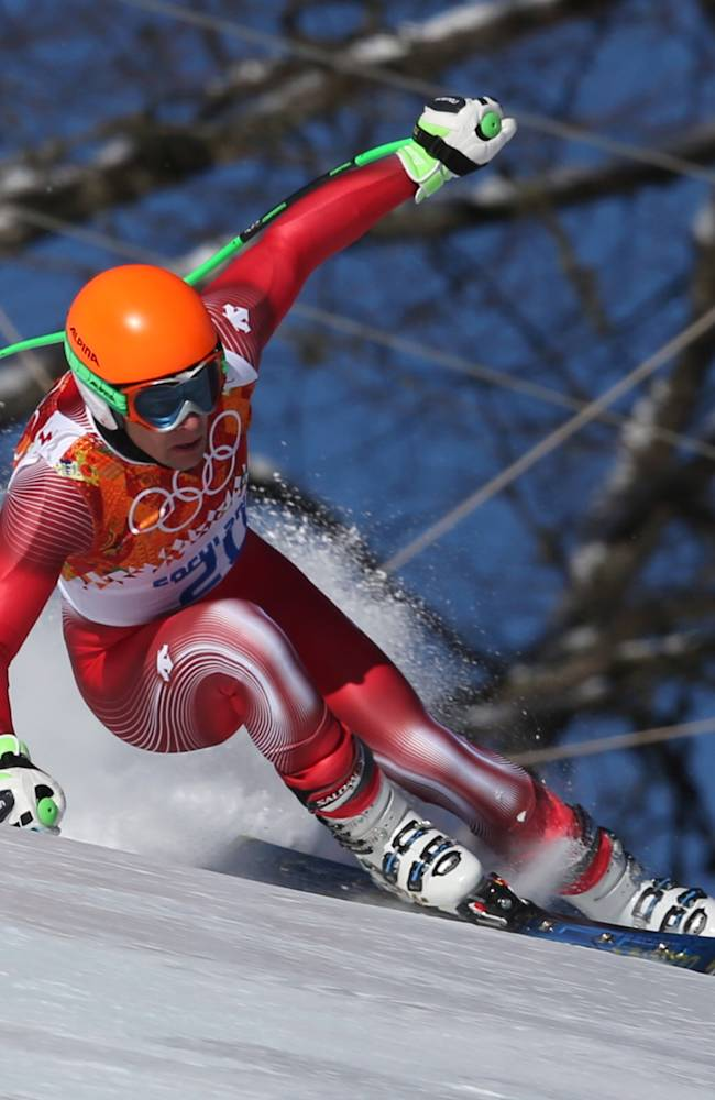 Switzerland's Patrick Kueng makes a turn during men's downhill training at the Sochi 2014 Winter Olympics, Thursday, Feb. 6, 2014, in Krasnaya Polyana, Russia. (AP Photo/Luca Bruno)
