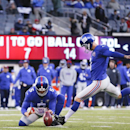 New York Giants kicker Josh Brown (3) kicks a field goal as punter Steve Weatherford (5) holds against the Washington Redskins during the third quarter of an NFL football game, Sunday, Dec. 14, 2014, in East Rutherford, N.J The Associated Press