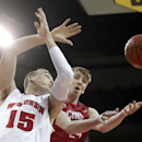 Wisconsin forward Sam Dekker, left, and Nicholls State forward Liam Thomas battle for a rebound during the first half of an NCAA college basketball game Saturday, Dec. 13, 2014, in Madison, Wis. (AP Photo/Morry Gash)