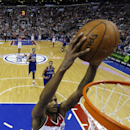 Washington Wizards' Trevor Ariza goes up for a dunk during the first half of an NBA basketball game against the Philadelphia 76ers, Saturday, March 1, 2014, in Philadelphia. Washington won 122-103 The Associated Press